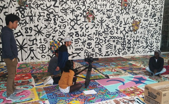 Participants shooting peer to peer interviews in Patrick Cruz's exhibition, Titig Kayumanggi (Brown Gaze).