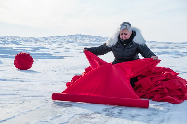 "Maureen Gruben prepares her materials for ""Stitching My Landscape"" on a section of the ice road outside Tuktoyaktuk, N.W.T. on March 9, 2017"