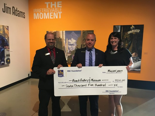 Grant cheque presentation at The Reach Gallery Museum Abbotsford featuring (l-r): Jason Epp, Branch Manager, RBC Royal Bank Sevenoaks, Jeff Starchuk, Branch Manager RBC Royal Bank Clearbrook, Laura Schneider, Executive Director & Curator, The Reach