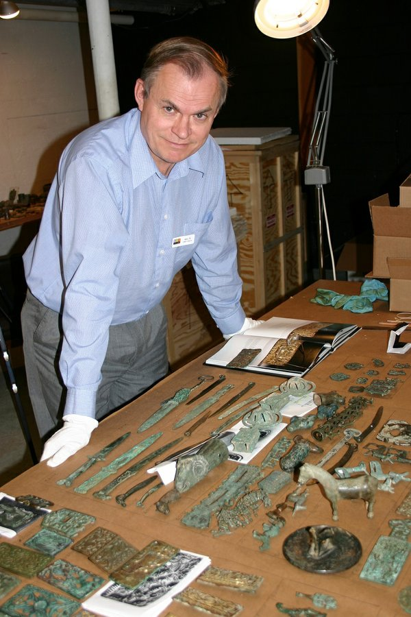 Curator of Asian Art, Barry Till in 2004, examining approximately 700 ancient Chinese bronze artifacts being donated by Mr. and Mrs. Joey and Toby Tanenbaum of Toronto