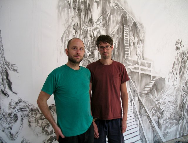 "Jim Holyoak (left) and Matt Shane pose as they work on their drawing installation, ""Forestrial Brain"" at Open Space in Victoria. Photo by Portia Priegert."