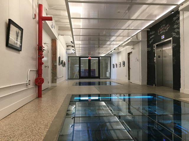 A glass floor offers a view of the old boiler room in cSPACE
