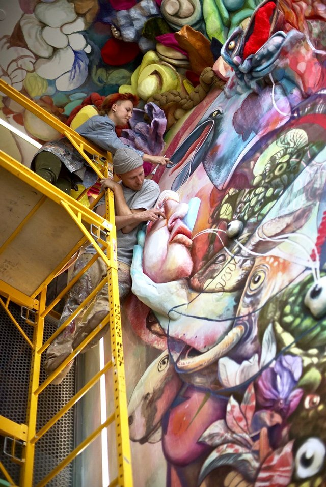 Daniel Kirk and Katie Green paint a mural at cSPACE earlier this year