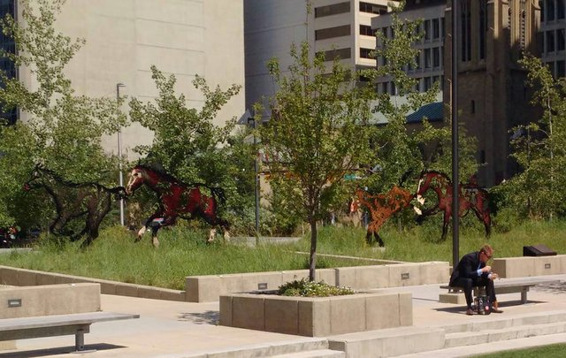"Joe Farfard's series of running horses, ""Do Re Mi Fa Sol La Si Do,"" in Calgary's Harley Hotchkiss Gardens earlier this summer."