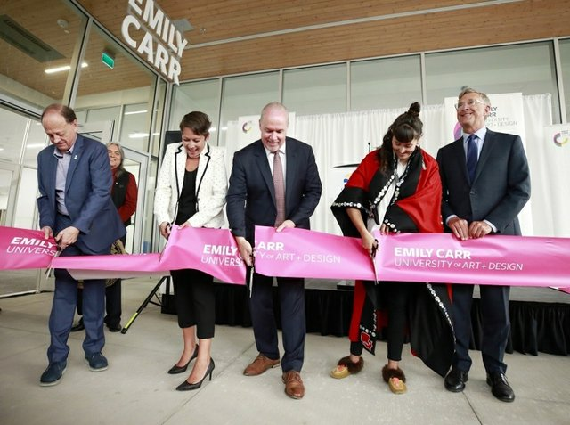 Ron Burnett, president  of Emily Carr University of Art and Design, at far left, helps Melanie Mark, the B.C. minister of advanced education, B.C. Premier John Horgan