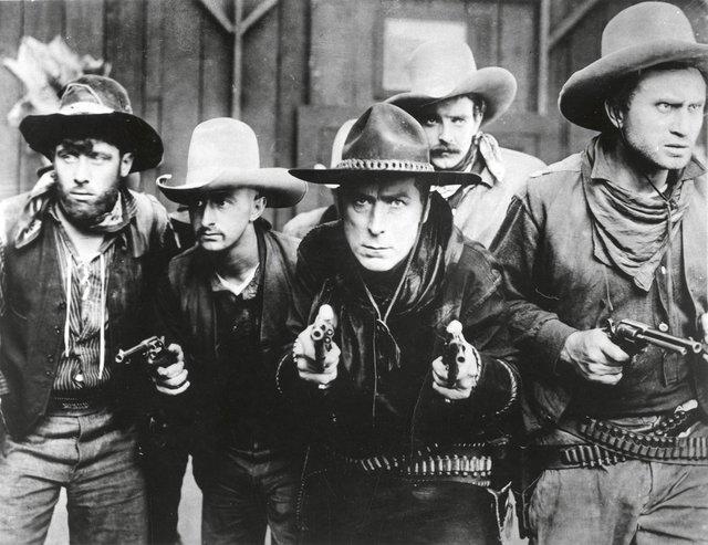 "William S. Hart (centre) in ""The Gun Fighter,"" 1917"