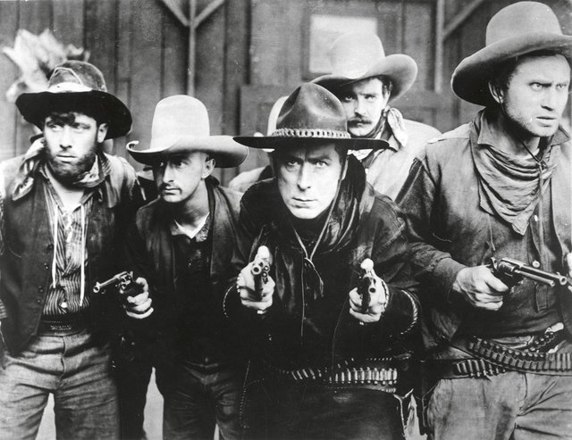"William S. Hart (centre) in ""The Gun Fighter,"" 1917"