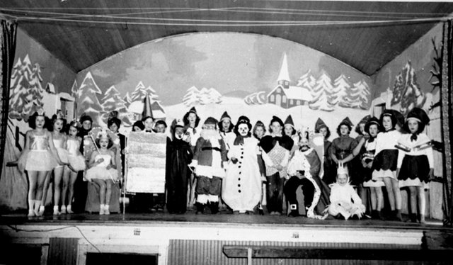 The Reach P5390- Children in costume, gathered on a stage at the Matsqui Hall for a winter pageant.