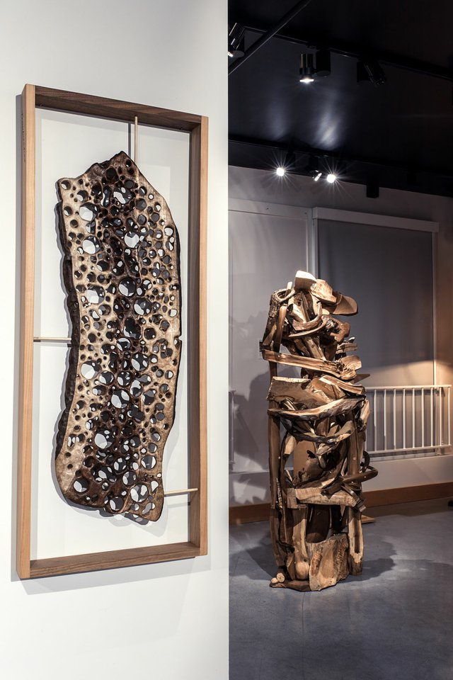"Arnim Roderick, ""Trouboisdoor,"" 2017, black walnut, 41"" x 16.5"" x 2.5"" (foreground) and David Martinello, ""Leaving Zenith,"" 2017"