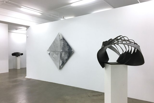 "Installation view featuring ""Cut / Drawn 6M,"" in foreground, and ""Cut / Drawn 6S"" by John Patkau and ""Intended Augmentation"" by Markus Schaller (photo by Shane O'Brien)"