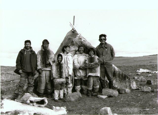 Left to right, Norman Cohn, Pauloosie Qulitalik, Lizzie Qulitalik, Mary Qulitalik, Rachel Uyarashuk, Jonah Uyarashuk, Zacharias Kunuk, on the set of Nunaqpa (Going Inland), 1990