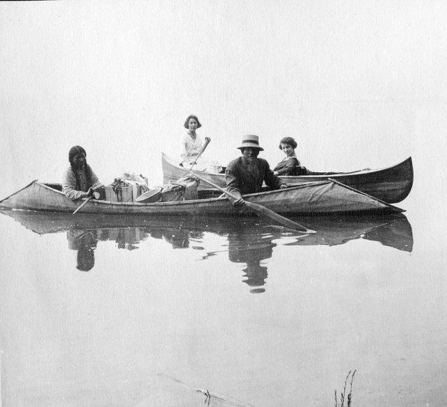 Kootenay Lake First Nations, Summer 1922. Phyllop Peter and his wife in the front boat