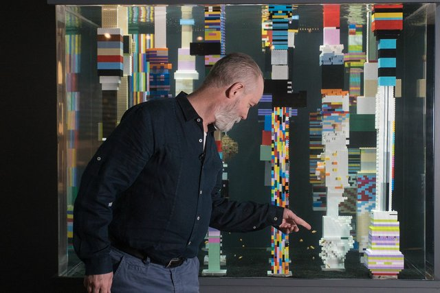 "Douglas Coupland with a Lego installation that's part of his exhibition, ""Vortex,"" at the Vancouver Aquarium. (Photo courtesy of Ocean Wise)"
