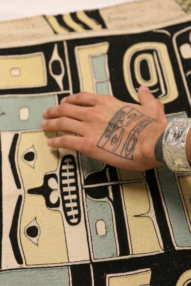 Chilkat robe and hand tattoo (image courtesy of Bill Reid Gallery, Vancouver)