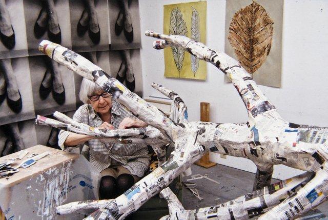 "Gathie Falk works on ""Winter Tree"" in her studio in 2012. (photo by Scott Massey)"