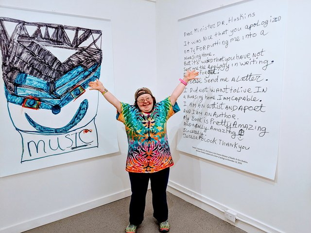 Teresa Pocock stands in front of the hand-written letter she sent to the Ontario government. (Photo by Billiam James)