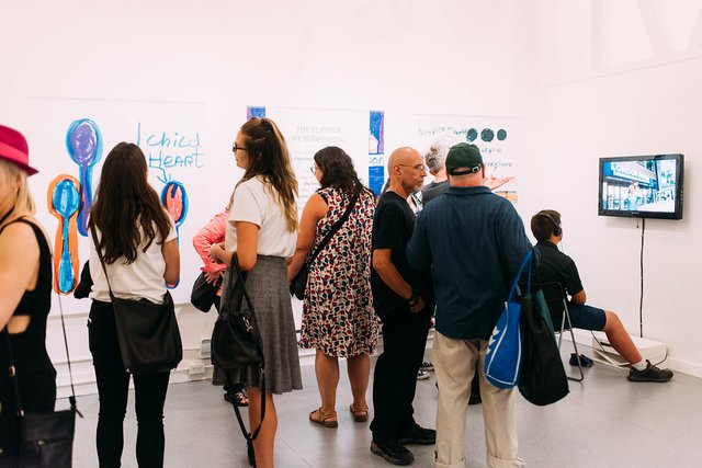 Visitors check out Teresa Pocock's art and writing at Gallery Gachet. (Photo by Melissa Newbery)