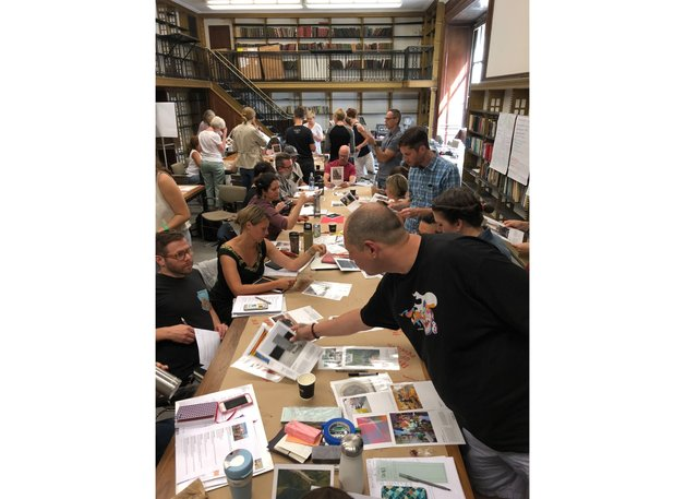 Teachers work on their projects at the New York Public Library. (photo by Dana Helwick)