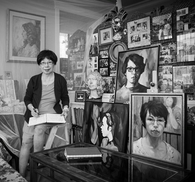 Betty Woo with sketchbook & self-portraits (photo by Donna H. Hagerman)