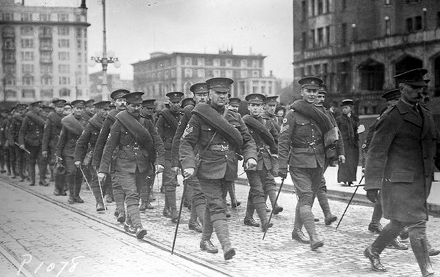 """Soldiers of the 48th Battalion (Canadian Expeditionary Force), marching down Government Street in front of the Empress Hotel, Victoria,"" 1915"