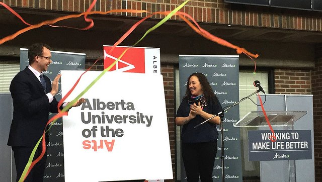 Minister Schmidt and Simone Saunders, student association director of leadership and governance at ACAD, unveil the new name and logo for the Alberta University of the Arts. (photo courtesy of The Government of Alberta)