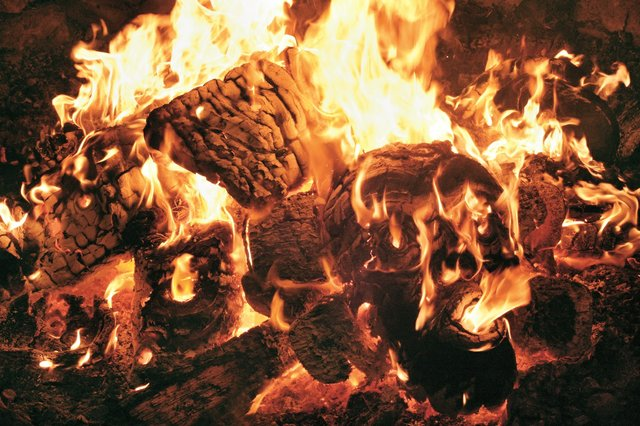Atlak'ima masks burn at Beau Dick's potlatch, hosted in the 'Namgis Big House, Alert Bay, B.C., in 2012. (photo courtesy of Steve Calvert)
