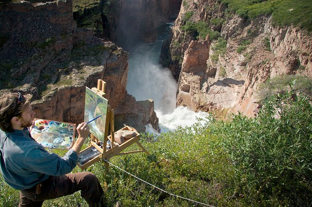 Cory Trépanier paints at Wilberforce Falls on the Hood River, west of Bathurst Inlet, Nunavut (photo by Max Attwood)
