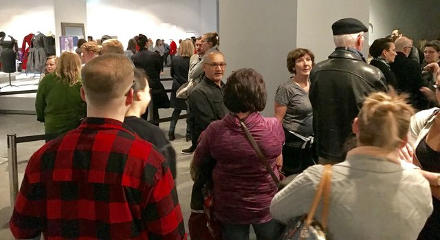 Visitors check out the Christian Dior show during a free evening at the Glenbow in Calgary. (photo by Richard White)