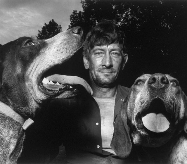 "Shelby Lee Adams, ""Chester with Hounds,"" 1992 (private collection)"