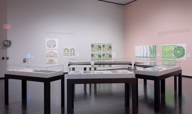Installation view of architectural renderings by Douglas Cardinal Architect Inc. (photo by Charles Cousins)