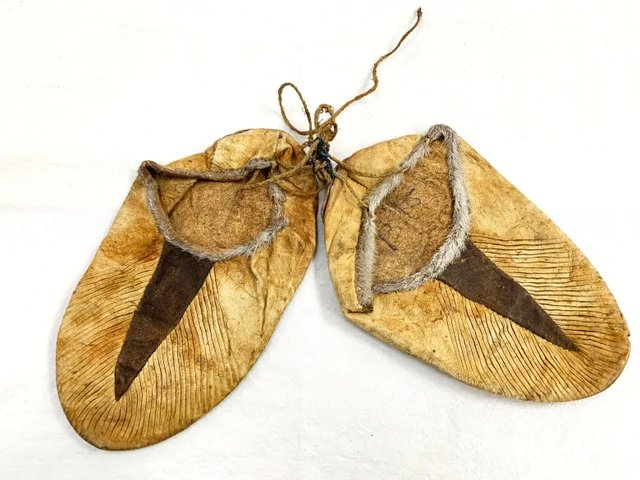 This pair of crimped kamiks made of bleached seal skin is more than 100 years old and among the artifacts added to the Diamond Jenness collection in Cambridge Bay, Nunavut. (photo courtesy of Pitquhirnikkut Ilihautiniq / Kitikmeot Heritage Society)
