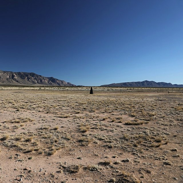 """Mary Kavanagh, """"Trinity atomic bomb test site with obelisk, White Sands Missile Range, New Mexico,"""" 2019"""
