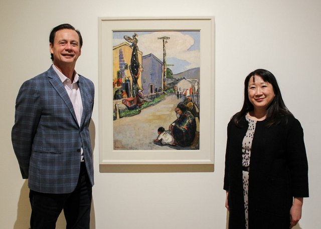 "Curtis Collins, director, and curator Kiriko Watanabe, Gail with Emily Carr's ""Street, Alert Bay,"" 1912"