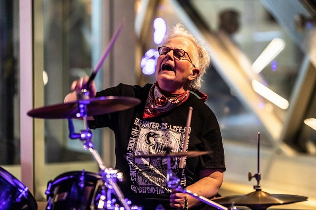"Calgary artist Rita McKeough on drums at the opening last month of a group show that includes her work, ""Rebellious: Alberta Women Artists in the 1980s,"" at the Art Gallery of Alberta. (photo by Leroy Schulz)"