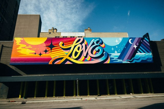 """New York artist Queen Andrea created this mural, """"Love All Day,"""" on Garry Street in Winnipeg as part of this year's Wall-to-Wall mural festival. (photo courtesy of Synonym Art Consultation)"""