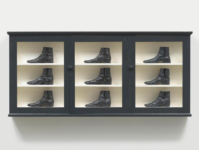 """Gathie Falk, """"Single Right Men's Shoes: Bootcase with 9 Black Boots,"""" 1973 (Collection of the Vancouver Art Gallery; photo by Rachel Topham, Vancouver Art Gallery)"""