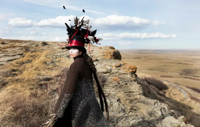 "Meryl McMaster, ""Edge of a Moment"" (at Head-Smashed-In Buffalo Jump), 2017 (photo courtesy the artist)"