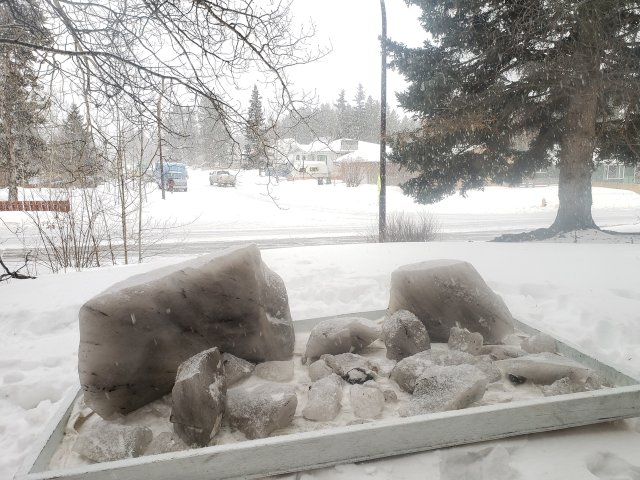 Several chunks of permafrost melt in Leslie Leong's front yard in Whitehorse. (courtesy of the artist)