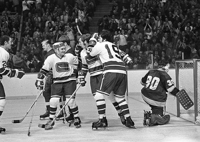 Celebrating the first goal by the new NHL 1970 Vancouver Canucks team. The goal was scored by #4 Barry Wilkins