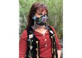 """Lisa Shepherd wears her mask """"Wâhkôhtowin,""""a Cree word that embodies relationship not just to family but to everything, including plants, animals, the earth and the sky. (photo by Martin Shepherd)"""