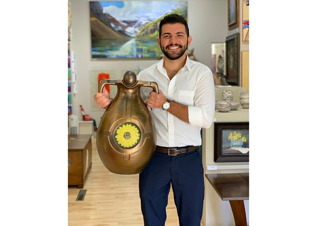 Tarek Nemr holds a ceremonial vase made by David Barnes at the Bluerock Gallery in Black Diamond, Alta. (courtesy Bluerock Gallery)