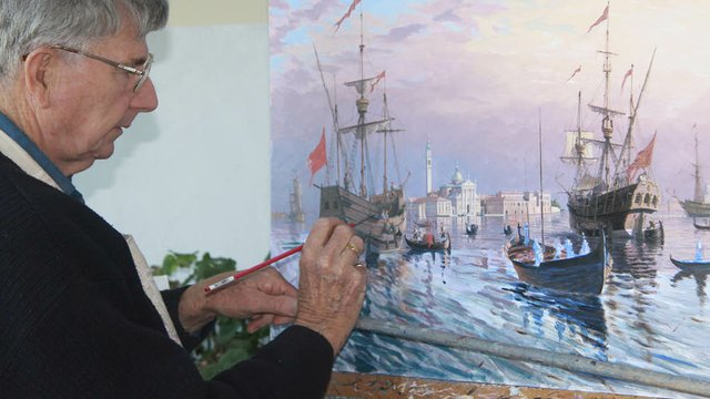 John Horton working on a painting.