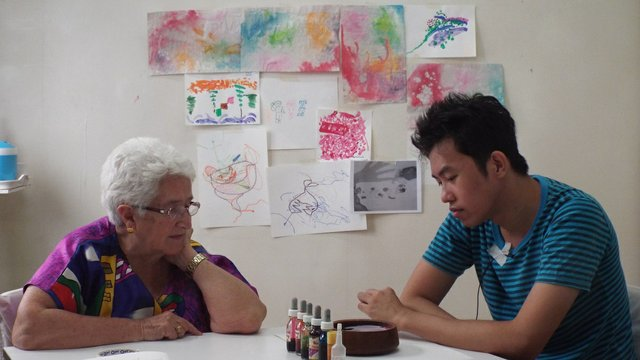 Art therapist Lucille Proulx (left) works with a client in Thailand. (photo used with client's permission, courtesy Canadian International Institute of Art Therapy)