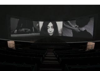 "Yoko Ono, ""Growing Freedom,"" three-channel film on the art and life of John and Yoko, featuring footage of ""Cut Piece,"" 1964"