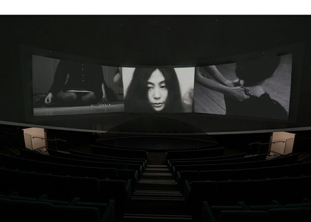 """Yoko Ono, """"Growing Freedom,""""three-channel film on the art and life of John and Yoko, featuring footage of""""Cut Piece,"""" 1964"""