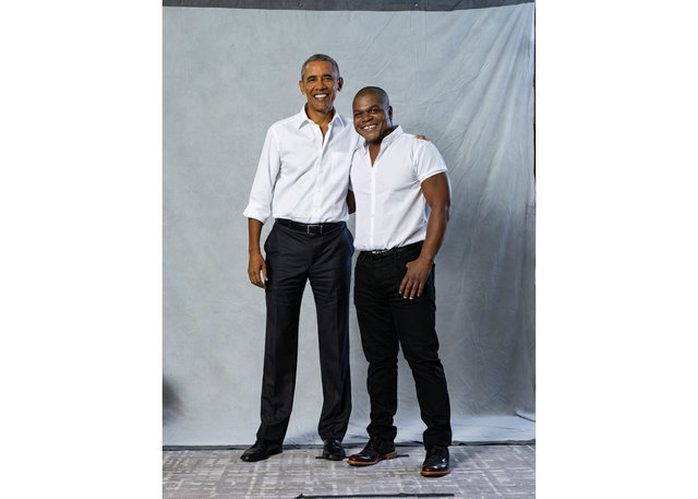 Barack Obama andKehindeWiley pose for a photograph during a sitting for the president's portrait in the summer of 2017.(photo by AinCocke, ©KehindeWiley, 2017)