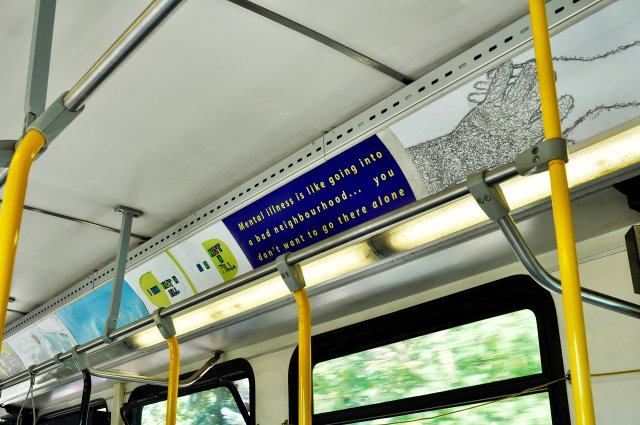 Artworks made by community participants, here including Kaj Korvela and Troy Farrar, were displayed in Calgary's transit system. (photo by Dick Averns)