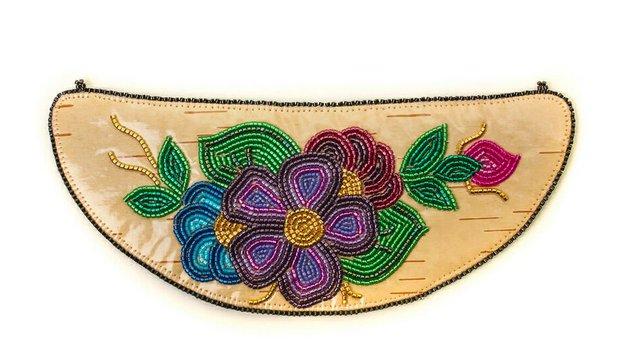 Sheena Yakeleya's beaded necklace on birchbark.(Sheena Yakeleya/NWT Arts)