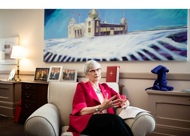 """Patricia Bovey in her Ottawa office with """"Winter Palace,"""" 2009,by Winnipeg artist David Owen Lucas. (courtesy the Senate of Canada)"""