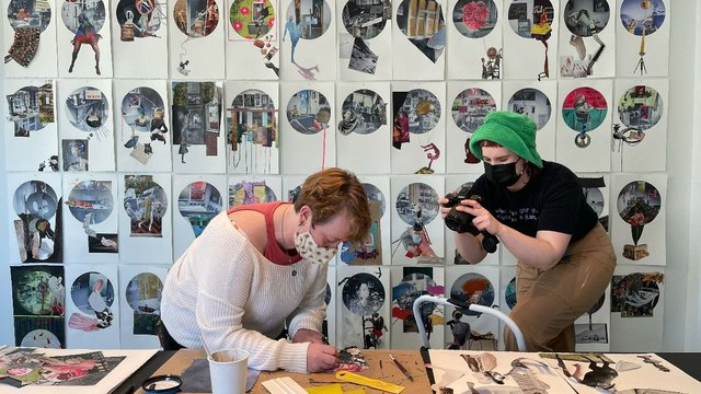"""Gabrille Moore (green hat) documents artist Anne Steves as she works on her collage project """"A Sense of Adandon / But Not a Lack of Discipline,"""" 2021"""
